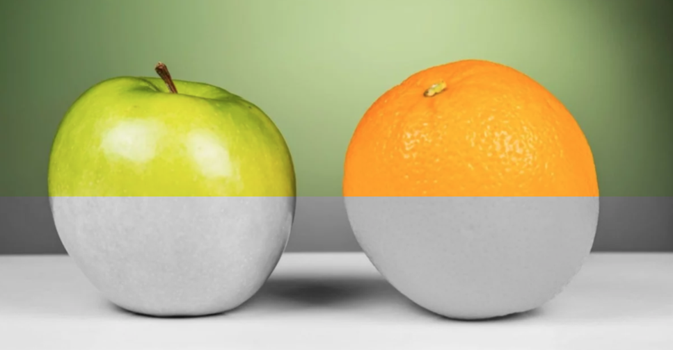 Green apple and an orange split to show in grayscale with poor contrast